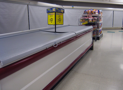 Image of grocery freezer night cover installation