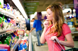 Image of woman grocery shopping